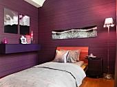 Modern bedroom with purple walls