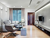 Light gray living room suite, wall mount TV and indirect lighting