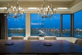 Modern dining room with city view at dusk
