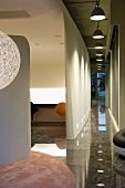 Marble hallway with pendant lights
