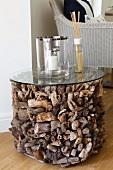 Cylinder of variously shaped driftwood pieces with glass top as unusual side table