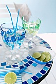 Printed cocktail glasses and dish on mosaic table