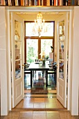Open double doors with view of dark wood table and chairs dining room