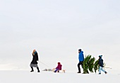 Family walking together in snow