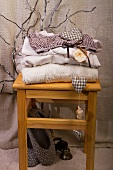 Stack of clothes on wooden stool