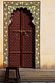 Brown Ornate Arched Door in the City Palace