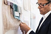 Businessman examining fabric swatches