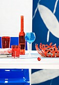 Table set in shades of red & blue (detail)