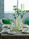 Spring atmosphere; set table with glass candlesticks