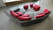 Modern gray sofa with pink throw pillows