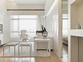 Upholstered post modern stools and side tables next to a white sofa