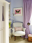 Antique armchair and modern standard lamp in corner of lilac room next to floor-length curtain at window