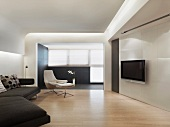Minimalist living room with a flat screen TV and suspended ceiling with indirect lighting