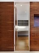 Brown wooden door to empty room