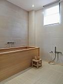 Modern bathroom with wooden bathtub