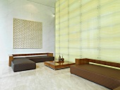 Sitting area in lobby with illuminated wall
