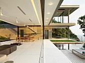 Open modern home with hidden pocket doors