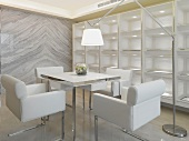 Square dining table and reading light in white modern home