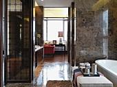 Hallway between bathroom and vanity area in home
