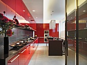 Kitchen with bright red cabinets