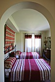 Wrought iron twin beds with striped bed linen in bedroom (Villa Octavius, Lefkas, Greece)