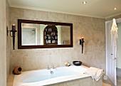 Bathroom with bathtub, scone lamps and mirror (Villa Octavius, Lefkas, Greece)