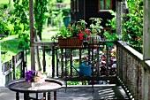 Planters on veranda of farm house