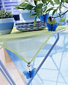 Decorative butterflies clipped to a table cloth and a small tree