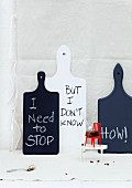 Diet reminders written on chopping boards and brownie on miniature chair