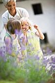 woman and little girls in a garden