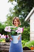 woman offering a bucket of flowers