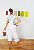 Woman looking at colour swatches on wall