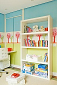 For kids - landscape wall stencils and sliding closet doors; in front open shelving with toys