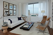 Modern Living Room with a White Sofa and Drapes; City Views
