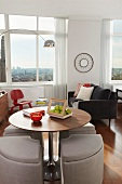 Dining Table and Living Area in a Studio Apartment with City Views
