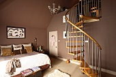 Spiral staircase in a roomy bedroom with brown walls