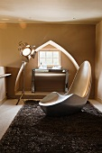 Designer chair in front of window niche shaped like a Reuleaux triangle