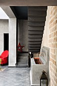 Sink and red armchair in courtyard of Marrakesh home