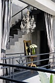 Silver curtains with glass chandelier in Moroccan courtyard home
