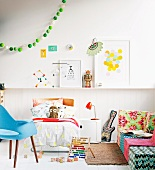 Child's room with a bed, colorful sofa and ball light chain