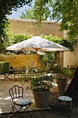 Parasol and seating area in grounds of Provence country house