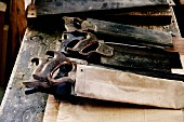 Old tools lying on rustic wooden table