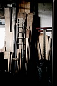 Dark store room with wooden boards leaning on wall