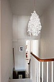 Midsummer paper lamp shade by Tord Boontje in staircase hallway