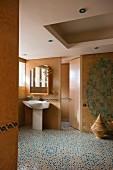A spacious bathroom with moroccan tile floor or Zellige floor