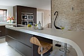 Elegant kitchen in shades of brown with curved kitchen counter