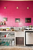 Elevation view of concrete kitchen counter with deep pink wall