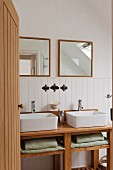 Double vanity unit with square mirrors and wood wall panelling