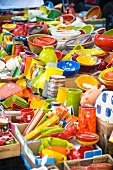 Colourful crockery on market stall