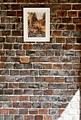 Impressionist painting on exposed brick wall
